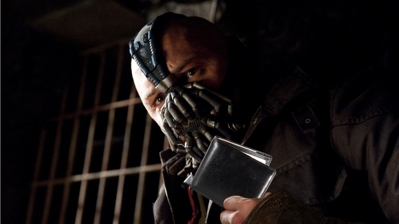Bane looks silly holding a wallet