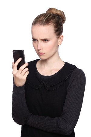 Shutterstock unhappy woman with mobile phone