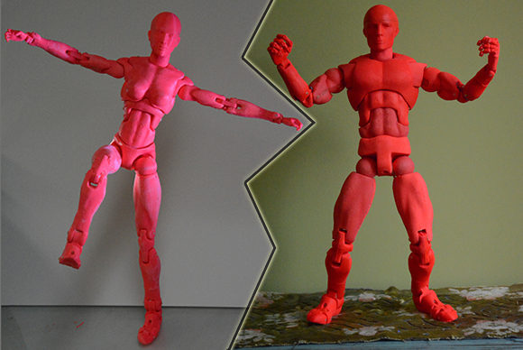 two 3d printed action figures. one male, the other female