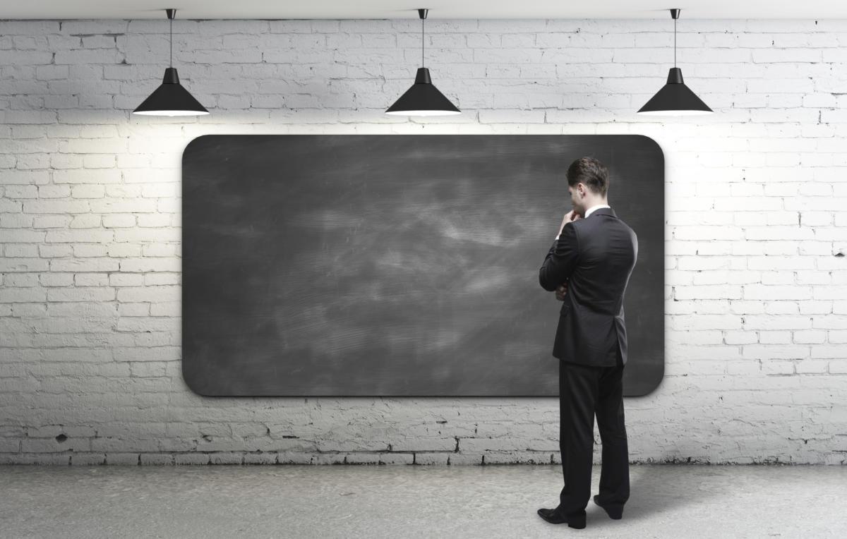 Man brainstorming at blackboard 181422978