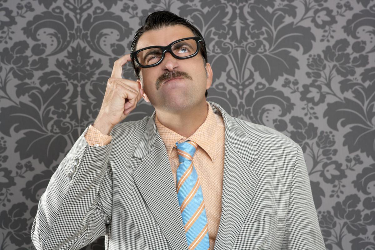 Nerd businessman pensive gesture silly funny retro 123079430