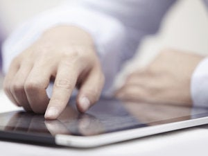 hand pointing at tablet mobile touch user