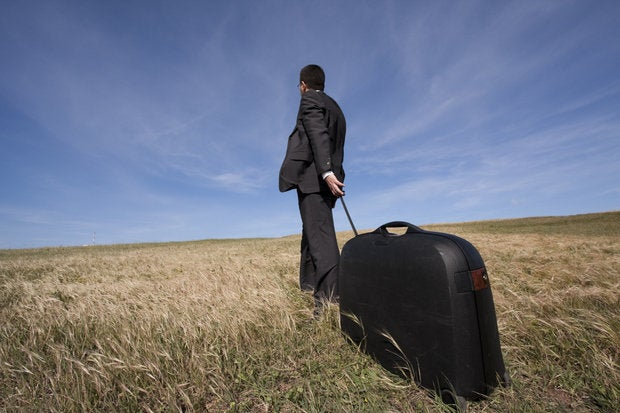 carrying briefcase across field