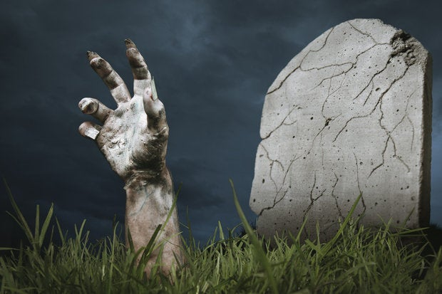 Zombie hand coming out of the ground 154213305