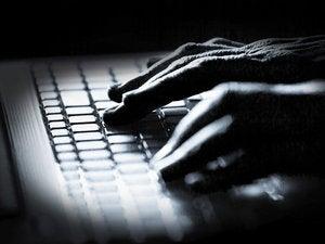 fingers typing keyboard dramatic lighting programmer hacker