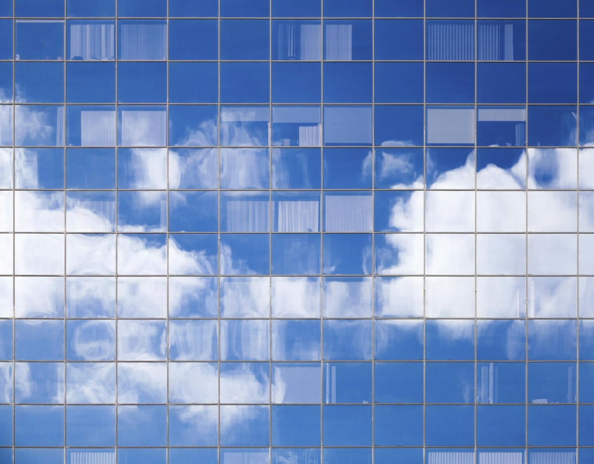 Abstract background texture with bright clouds in windows