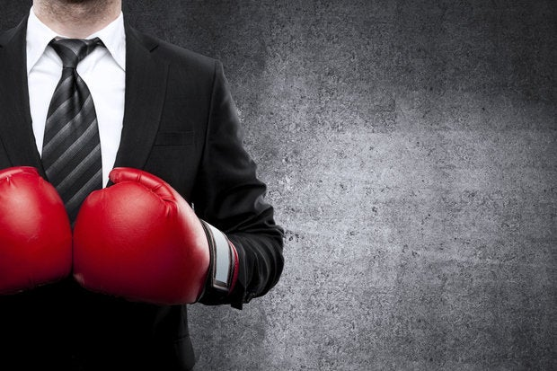 Man in boxing gloves 179985313