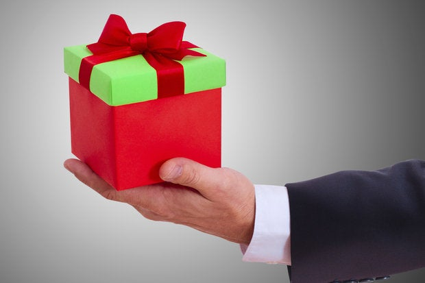 Businessman holding holiday gift box 187371991