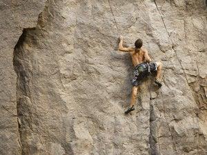 Rock climber bouldering    78807326