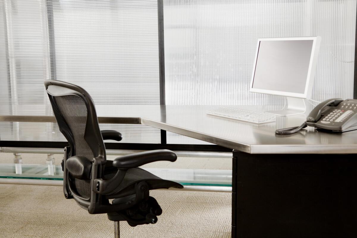 Empty cubicle desk chair