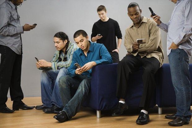 Young men with mobile phones
