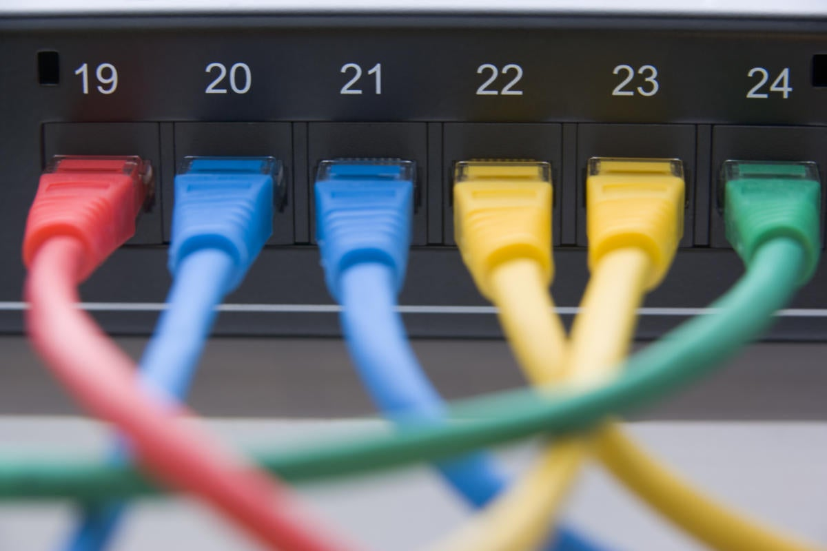 Computer cables connected to a router 84517144