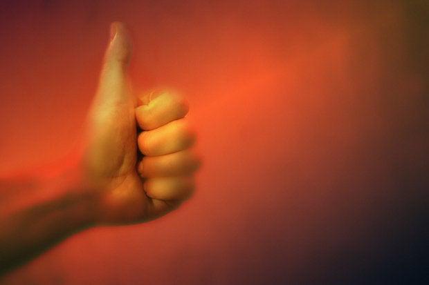 Thumbs up gesture 87345235