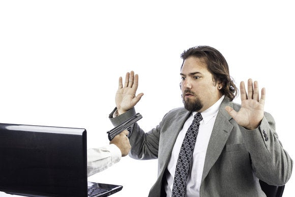 ransomware man pointing gun out of computer security