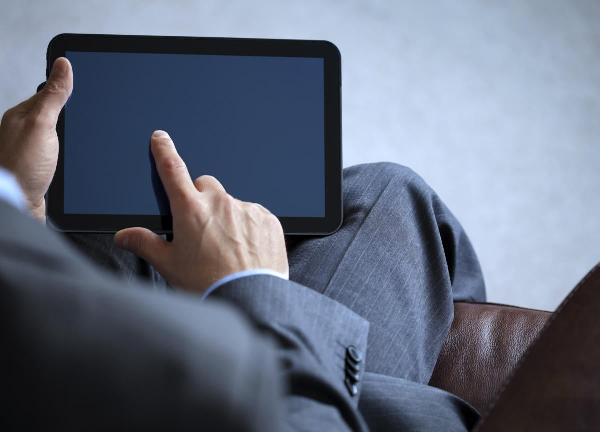 business man working on digital tablet 153986794