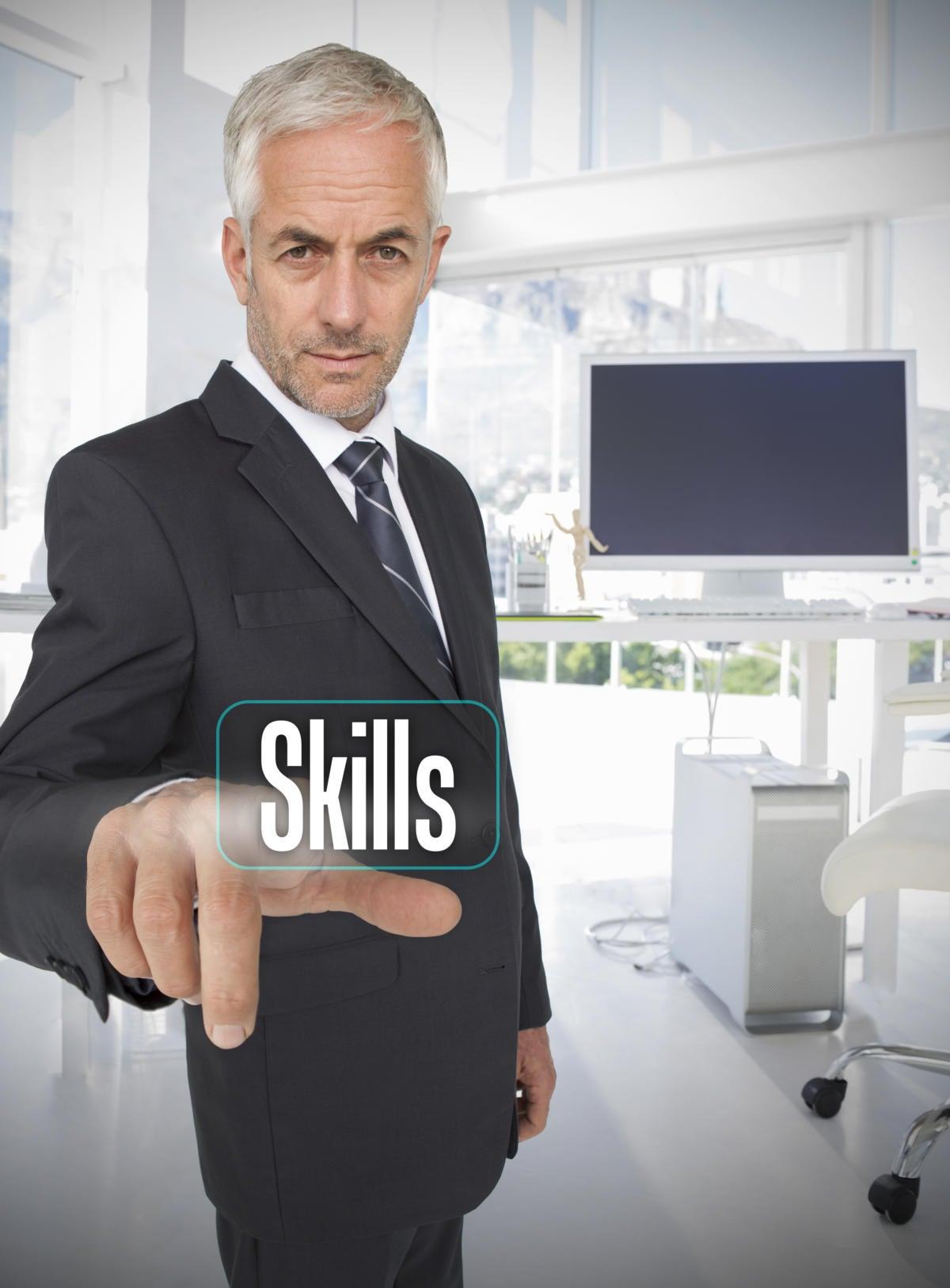 businessman selecting the word skills 175228552