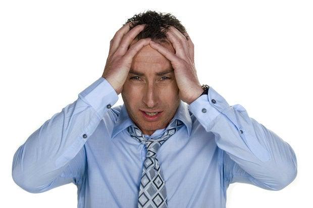 businessman with stress headache pain frustration