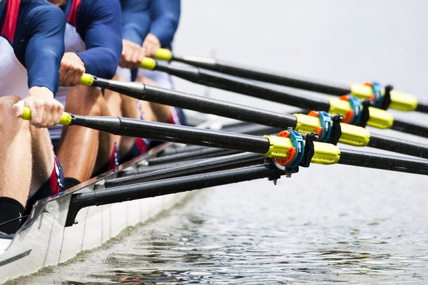 close up of mens rowing team sports cooperation