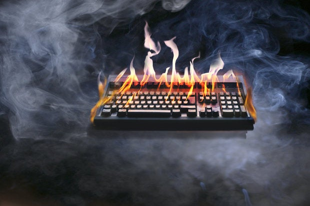 computer keyboard on fire 87584864