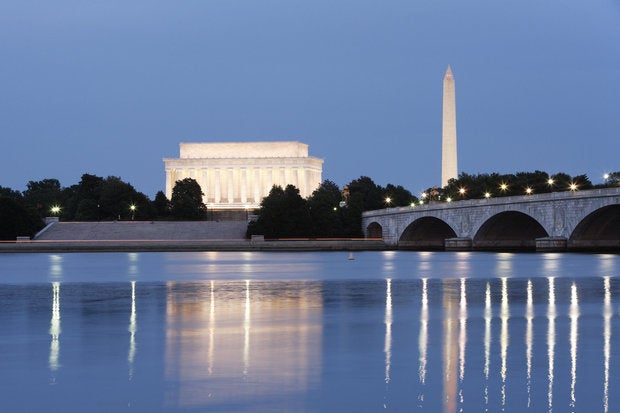 evening view of the lincoln memorial and washington monument reflected in the potomac river. 920316