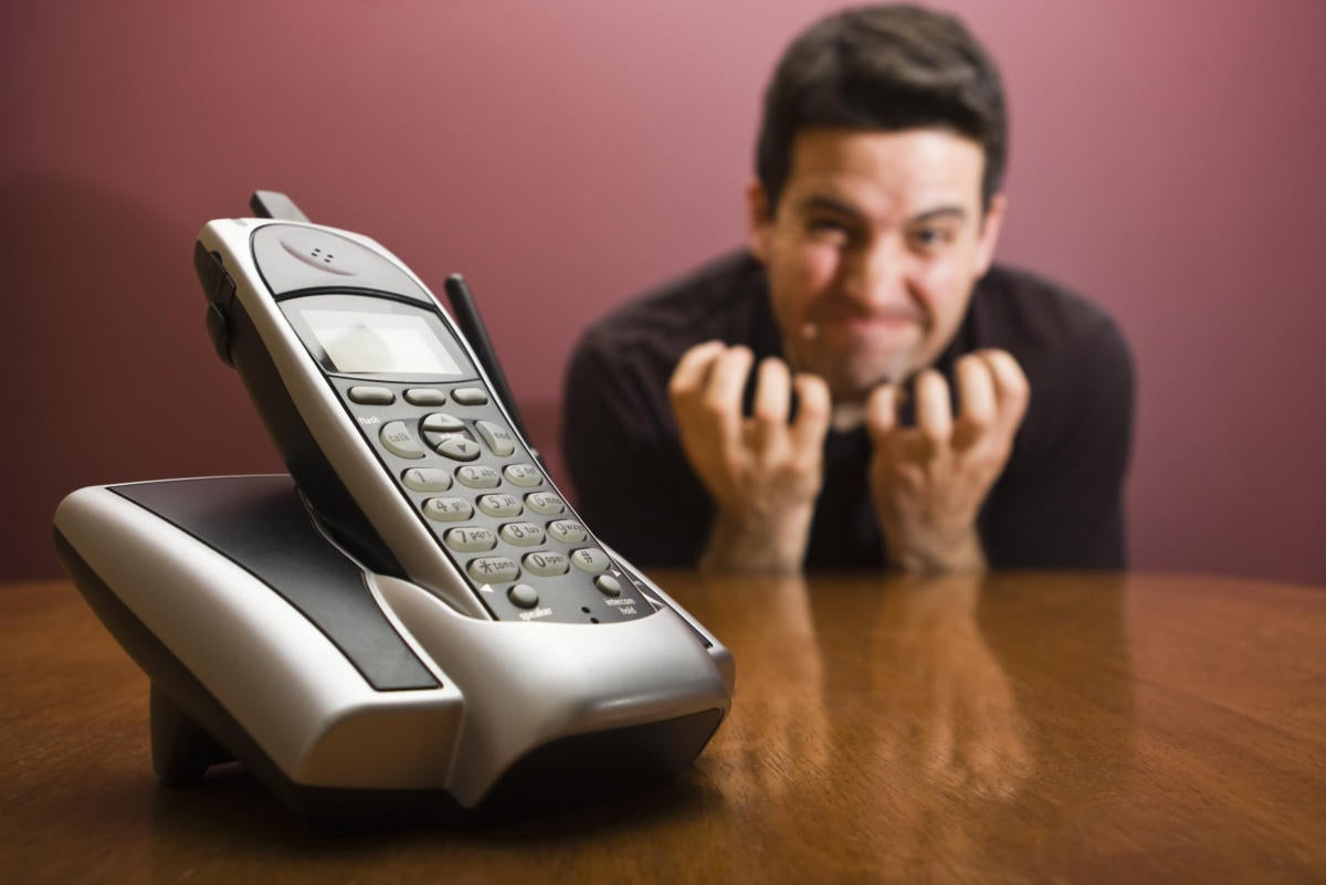 frustrated waiting for the phone to ring 137888054