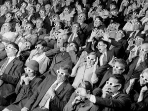 high angle view of group of spectators sitting in a movie theater wearing 3 d glasses 79072701
