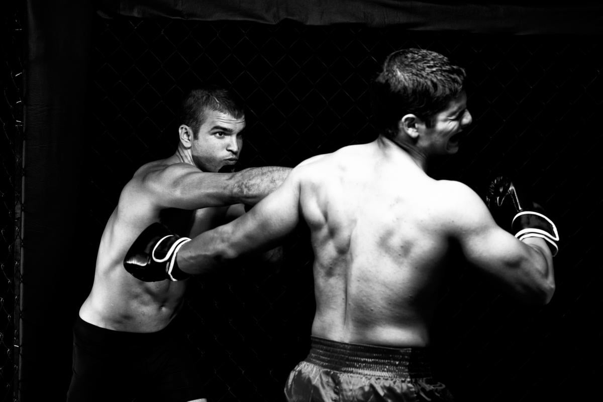 mixed martial artists fighting punching 136721959