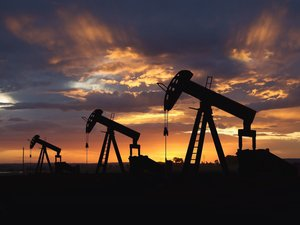 oil wells at sunrise 100838104