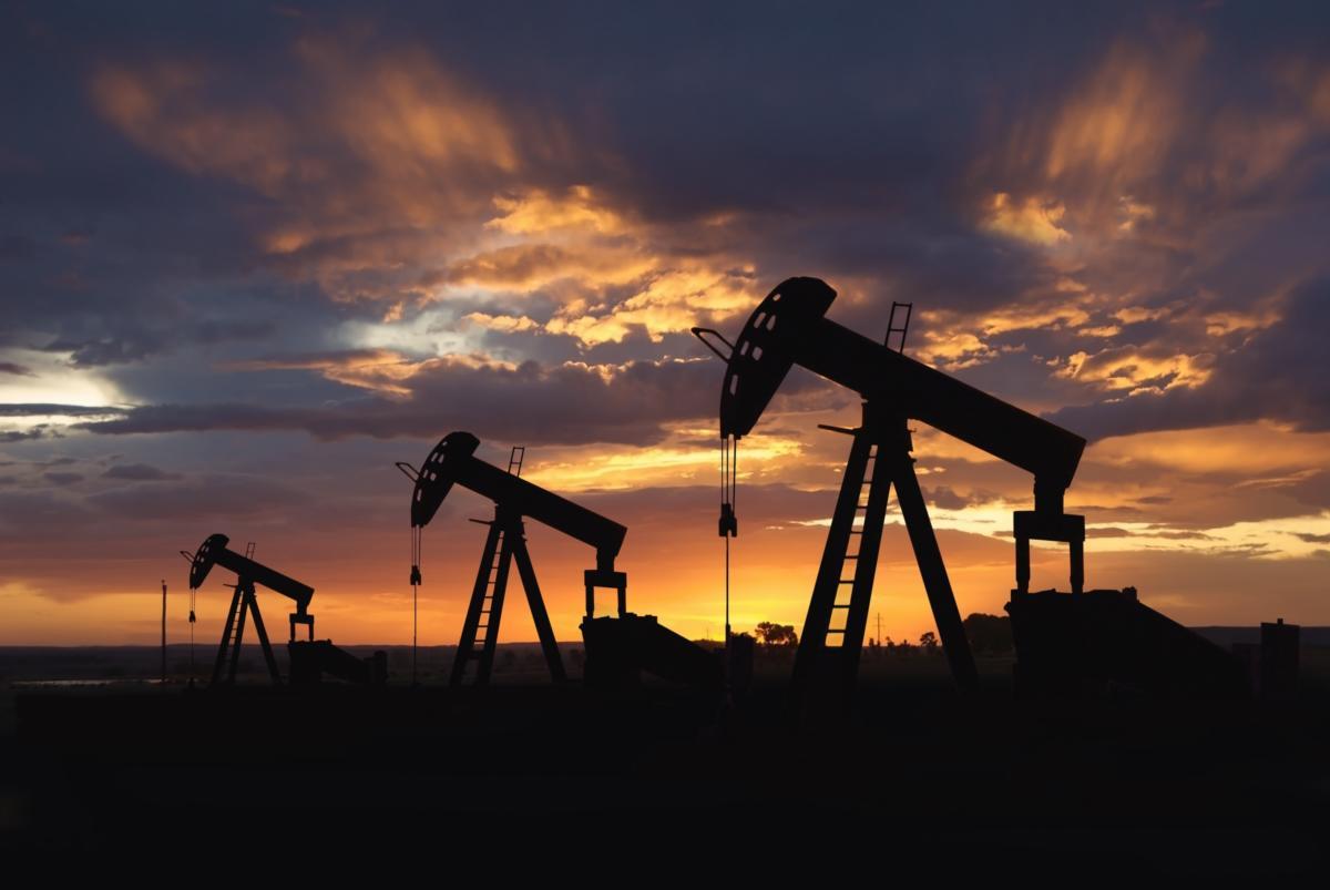 oil wells at sunrise 100838104