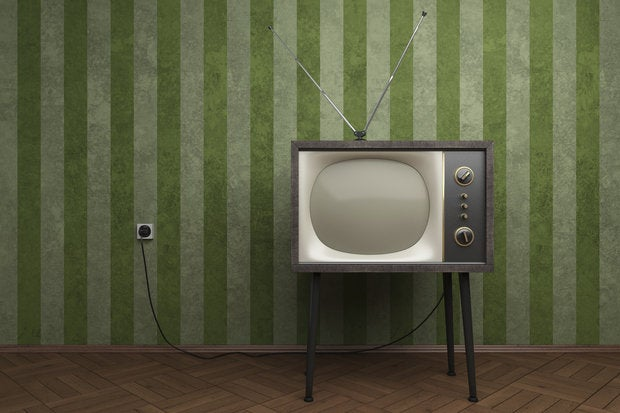old tv in empty room with green striped wallpapers 92362249