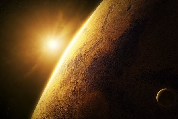 planet mars close up with sunrise in space 158456999