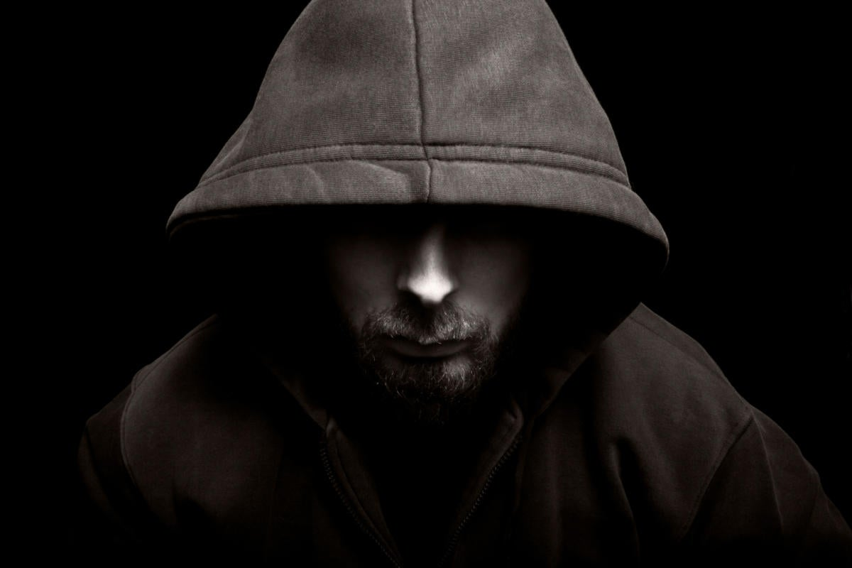 scary evil man with hood in the dark 100696889