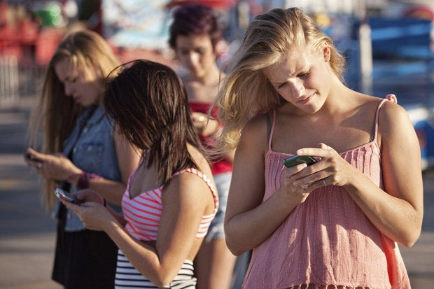 serious teenagers on smartphones 159021305