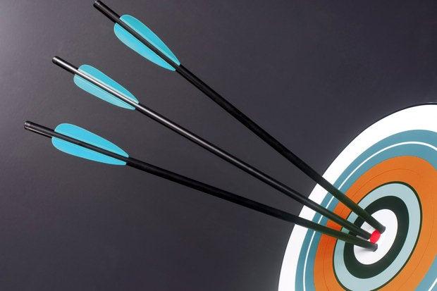 three blue black archery arrows hit round target bullseye center 167437636