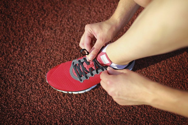 tying sports shoe 118291894