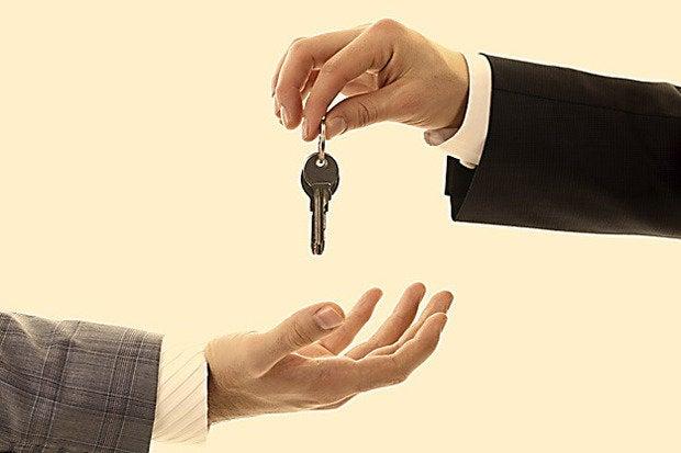 handing keys over business workers