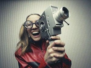 Wacky woman with movie/video camera