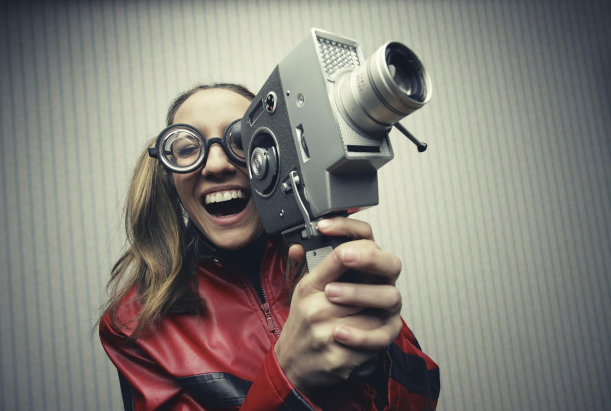 Wacky woman with movie/video camera