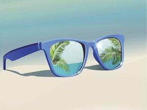 Blue sunglasses on the beach