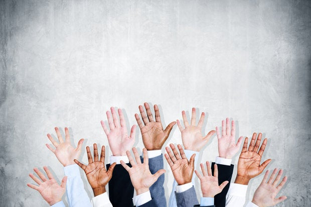 Group of executives with hands raised/volunteering