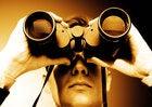 Man looking through binoculars preview look watching