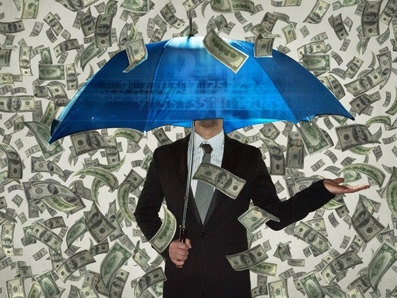 Man under umbrella raining money