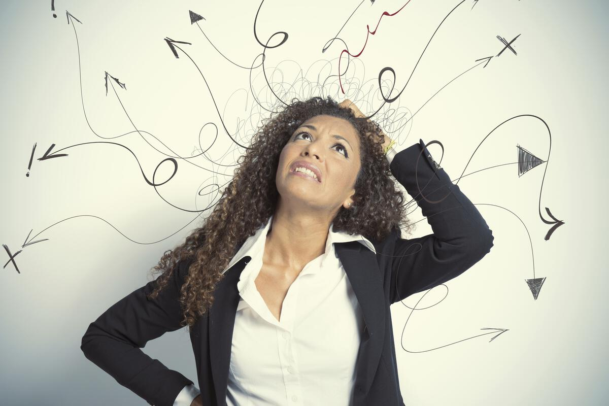Woman scratching her head with arrows and question marks around her