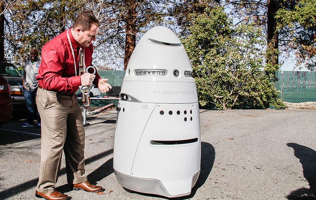 Knightscope K5 Robot With Man