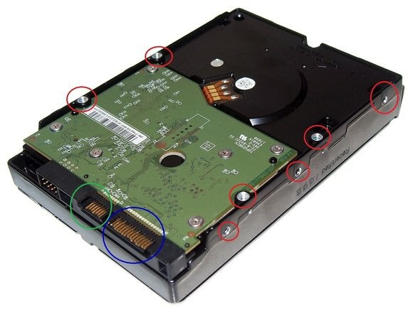 upside down hard drive showing screw holes