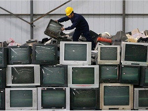 Chinese man on top of TV pile
