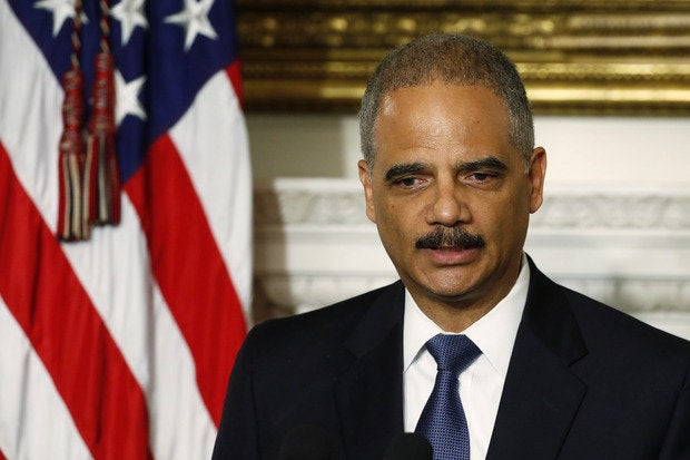 eric holder reuters larry downing