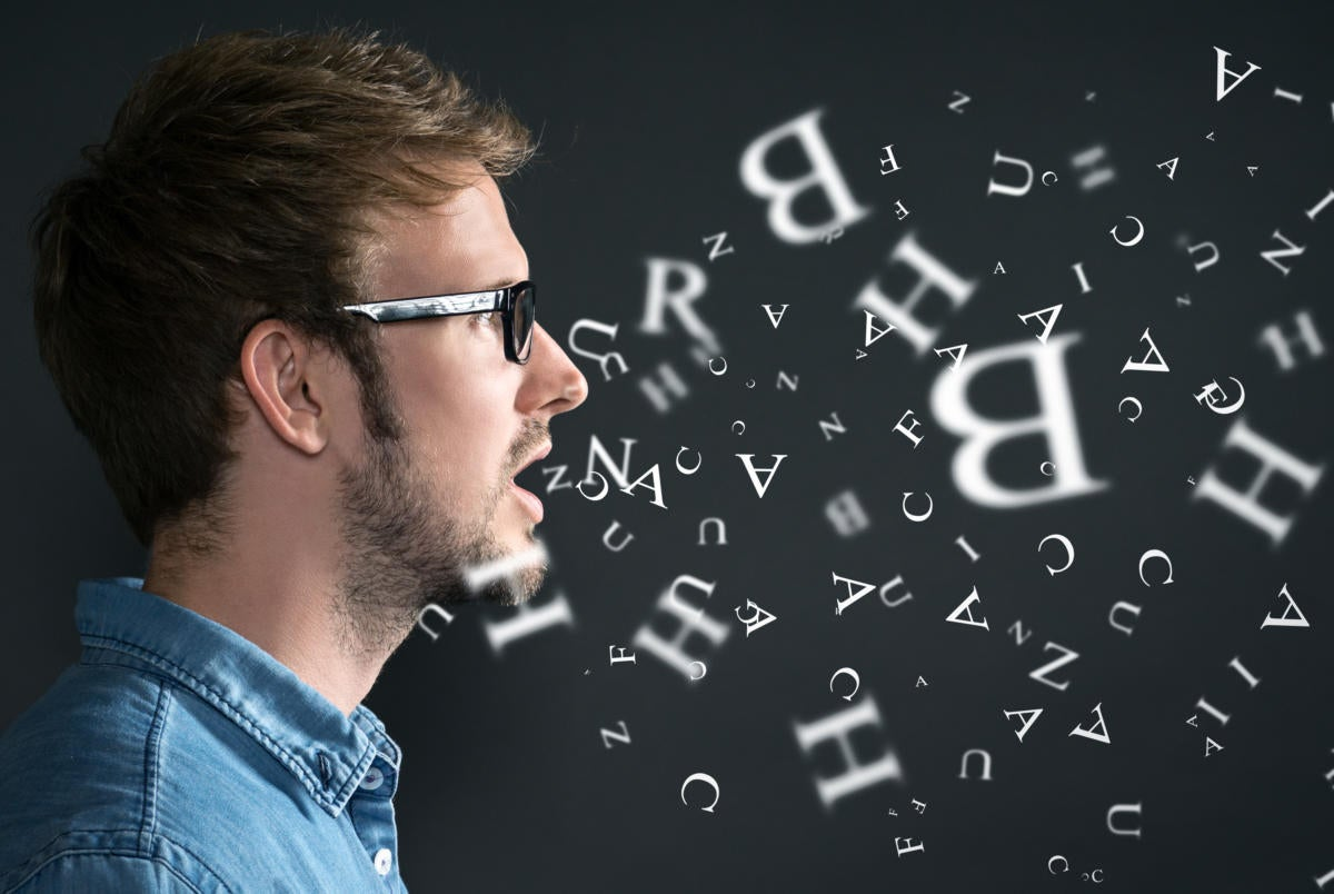 Young man speaking with flying letters coming out of mouth