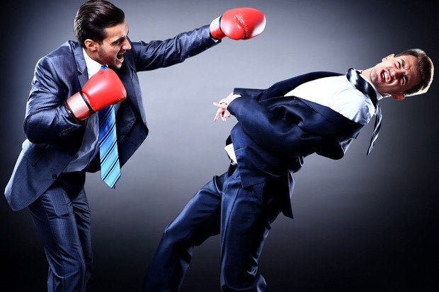 2 young executives boxing fight battle