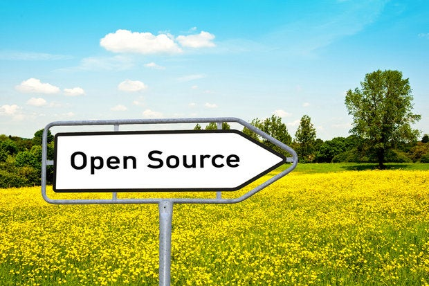 Open Source sign in yellow field against blue sky